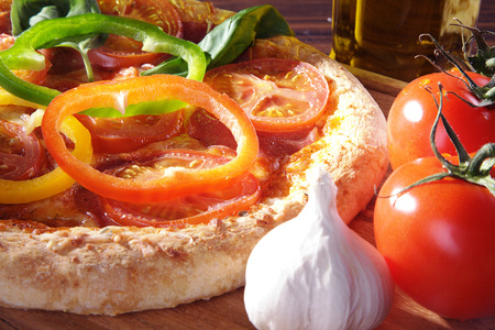 diat product: large tomatoes and garlic decorated with pizza