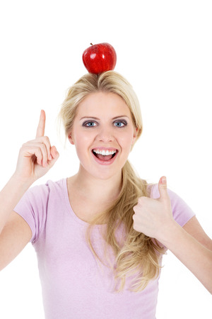 poised: beautiful woman poised with an apple