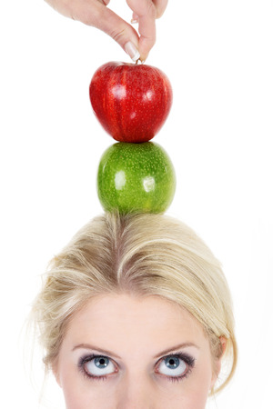 beautiful woman poised with an apple photo