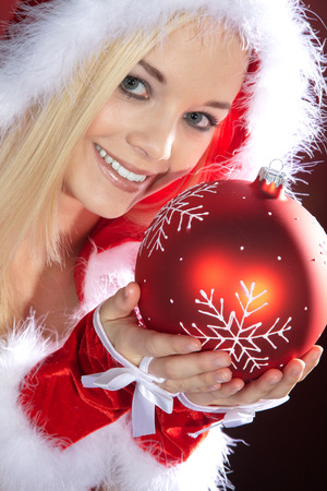 young woman with Christmas hat and xmas ball photo