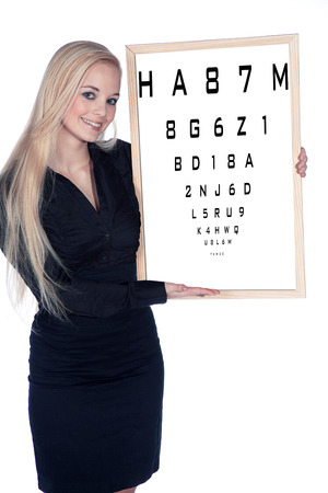 beautiful woman at eye test photo