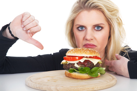 thump: beautiful model with Burger and thump down Stock Photo
