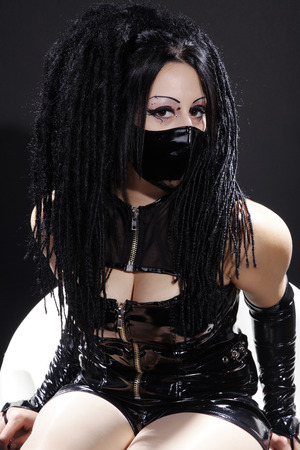 gothic fetish: beautiful gothic woman sitting with mouthpiece