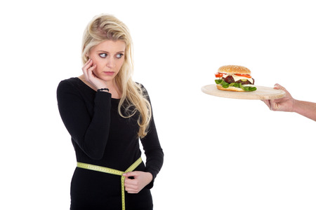 young beautiful model should not eat burger photo