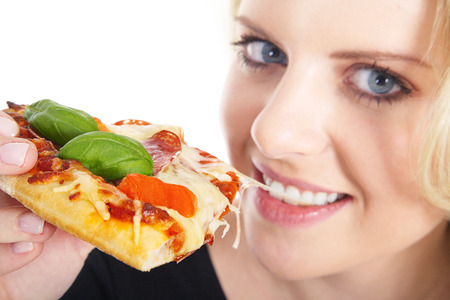 young beautiful model biting into a pizza 스톡 콘텐츠
