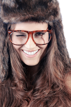 beautiful woman with brown fur hat and glasses photo