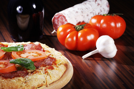 diat product: presents pizza on wooden cutting board with ingredients