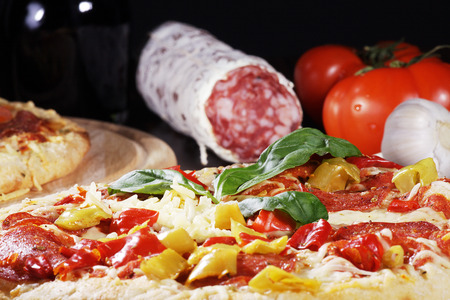 diat product: special pizza decorated with peperonie