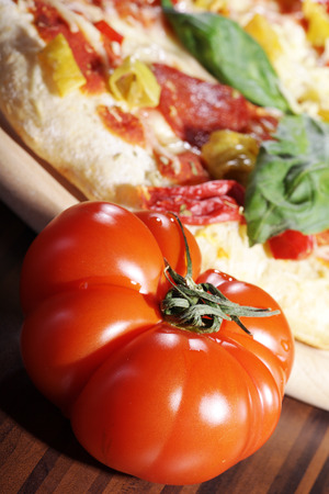 diat product: close up of a tomato with pizza