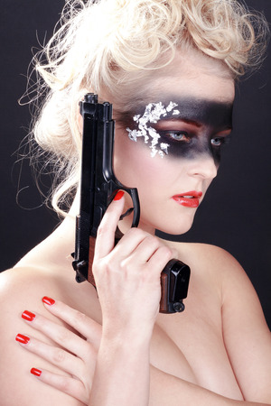 fashion face in black airbrush with gun photo