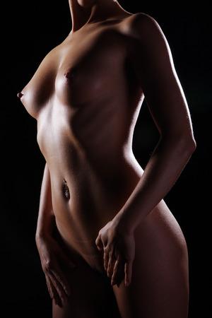 naked female body: Beautiful naked female body on a dark