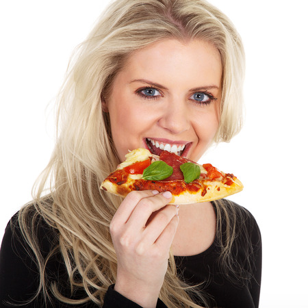 young beautiful model biting into a pizza photo