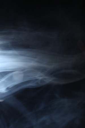 smoke in the light on a dark