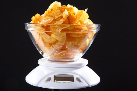 diat product: chips with a weight level Stock Photo