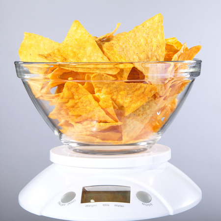 diat product: Nachos with a weight level Stock Photo
