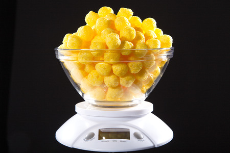 corn snack with cheese flavor with a weight level Stock Photo