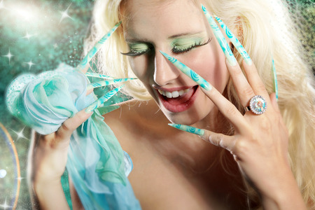 fashion woman with long nails in airbrushdesign photo