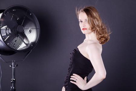 beautiful woman with big fan photo