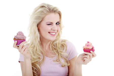 young woman with tasty cupcake 스톡 콘텐츠