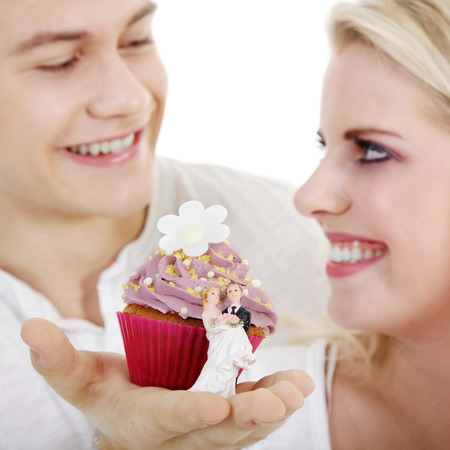 beautiful young couple with delicious cupcake photo