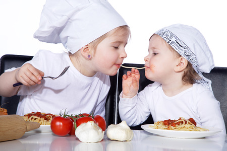 young little girl eating spaghetti photo