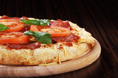 pizza with tomatoes and basil Stock Photo