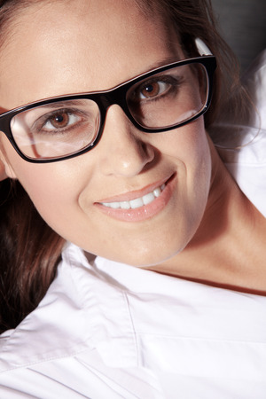 smile close up: beautiful woman with glasses and smile close up