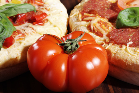 close up of a tomato with pizza
