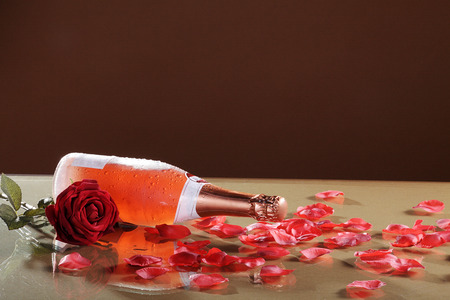 champagne bottle with red petals photo