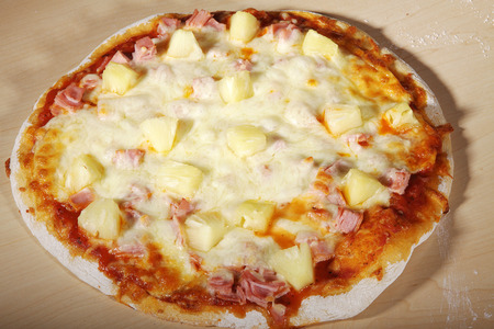 pizza ham with pineapple and cheese