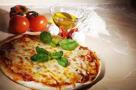 tomato pizza with olive oil and flour