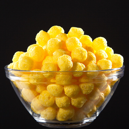 corn snack with cheese flavor in a glass bowl