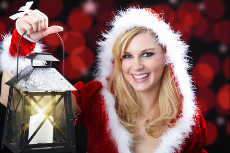 beautiful woman with christmas hat and lantern photo