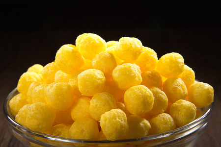 diat product: corn snack with cheese flavor in a glass bowl