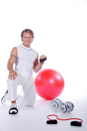 sporting goods: hermoso hombre de fitness con muchos art�culos deportivos