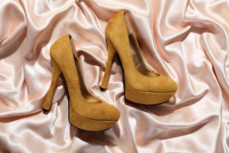 beautiful high heels on satin photo
