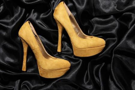 beautiful high heels on balck satin photo