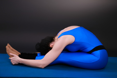 closed club: yoga woman showing a seated forward bend
