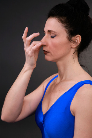 breathable: yoga woman shows exercise in changing breathable