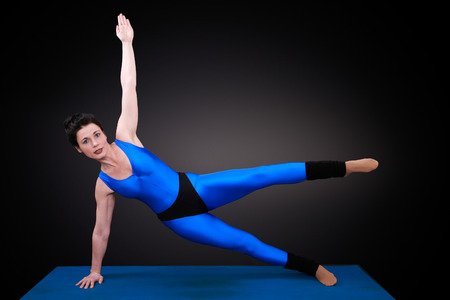 awry: yoga woman shows the position laterally awry level