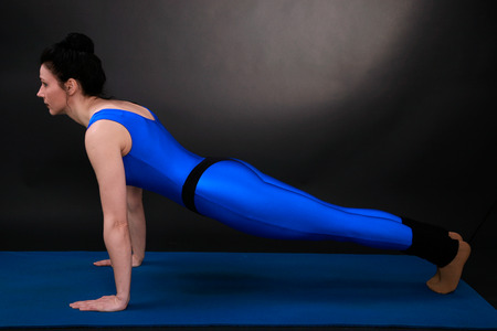closed club: yoga woman showing air stop, leg alternately