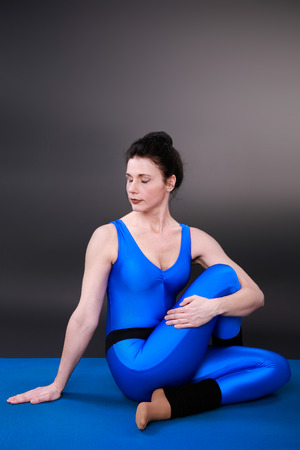 closed club: yoga woman shows the position rotating seat