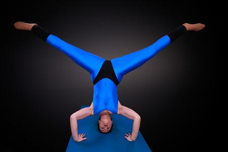 straddle: yoga woman shows a clown straddle