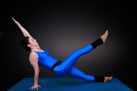 awry: yoga woman shows the position diagonally awry level