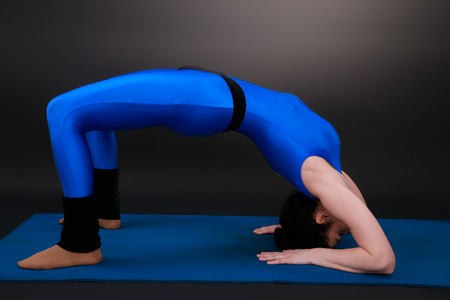 forearms: yoga woman shows the bridge  on forearms