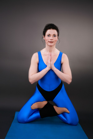 closed club: yoga woman shows the position Lotus mountain Stock Photo
