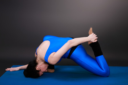closed club: yoga woman shows the position of the hero bent