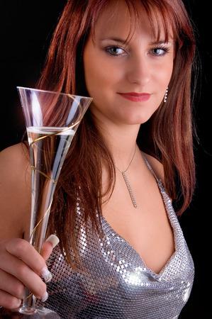 schöne Frau in Silber mit Champagner-Glas Standard-Bild