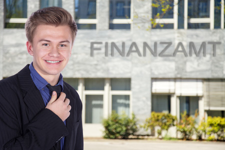 financial official: young financial official smiles Stock Photo