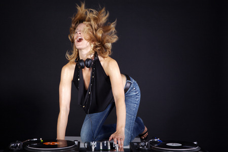Woman dj with mixing console